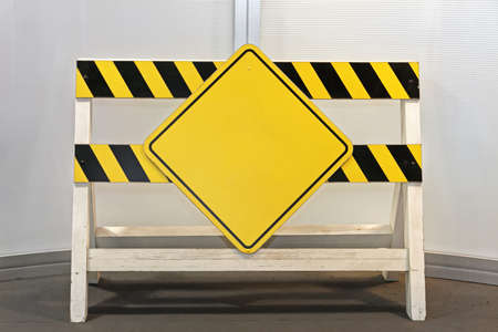 Construction Site Barrier With Yellow Warning Sign