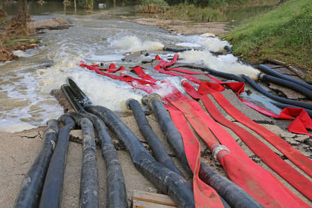 Pipes and Fire Hoses for Pumping Out Flood Water