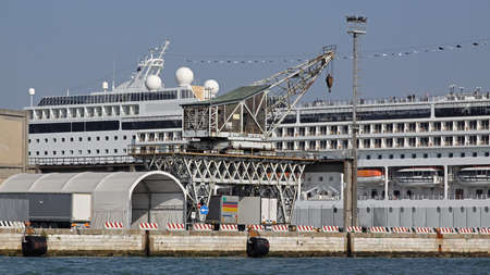 Loading Crane and Cruise Ship in Venice Harbour