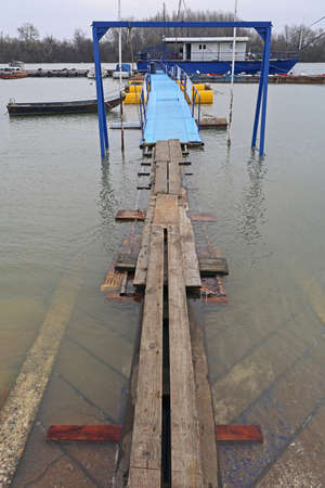 Floating Plank Bridge Boards Over Water Floods Stock Photo