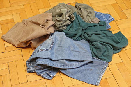 Bunch of Old Worn Out Old Clothes Stockfoto