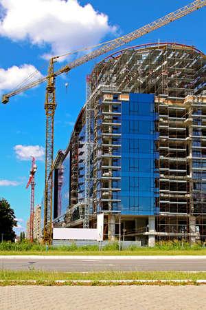 Commercial building with blue windows under construction Archivio Fotografico