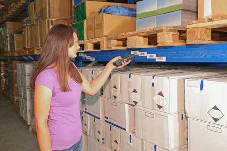 Woman Holding Barcode Scanner for Warehouse Invertory Management