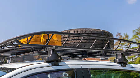 Spare Tyre and Jerry Can at Vehicle Roof Rack