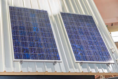 Two Solar Panels Cells at House Roof Banque d'images