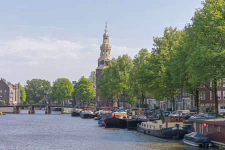 Houseboats Moored at Canal in Amsterdam Netherlands Stockfoto