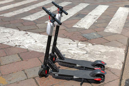 Electric Scooters for Rent Leaved at Street in City