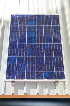 One Solar Panel Cell at House Roof Imagens