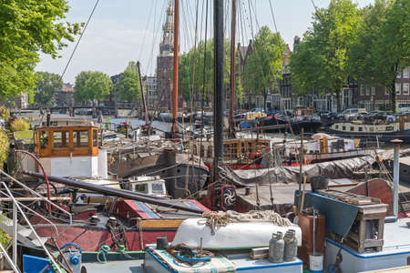 Wooden House Boats Moored at Canal in Amsterdam 스톡 콘텐츠
