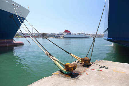 Moored Ships and Ferryboats in Port of Piraeus Greece