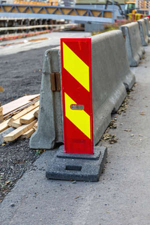 Vertical Panel Barrier Warning Sign at Construction Site