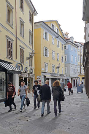 Trieste, Italy - October 14, 2014: People Walking at Pedestian Zone Streets Downtown in Trieste, Italy.