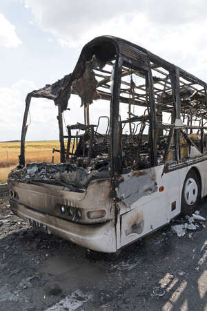 Burned Coach Bus Vehicle at Highway Accident Stock Photo