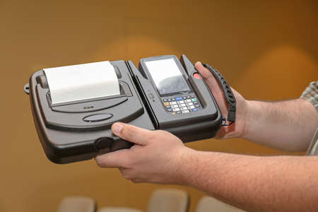 Man Holding Portable Barcode Printer and Reader Computer Device