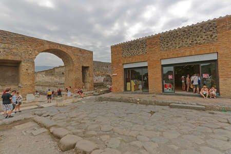 Pompei, Italy - June 25, 2014: Hungry Tourists at Autogrill Restaurant in Ancient Roman Ruins Near Naples, Italy.