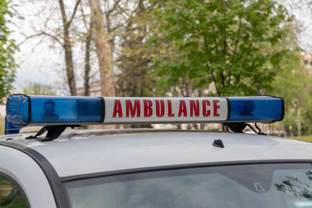 Ambulance Sign With Blue Lights Bar and Siren Stock Photo