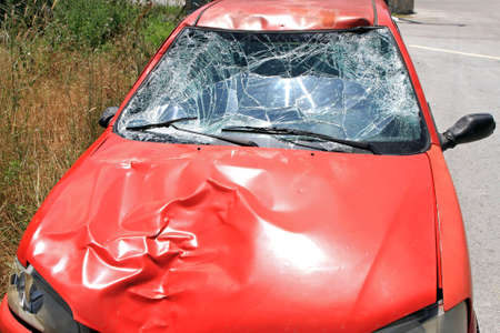 Broken Windschield at Red Car in Traffic Accident