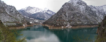 Piva Lake and Snow Mountains in Montenegro