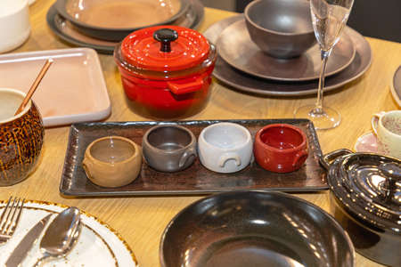 Contemporary Earthware Bowls and Plates at Table