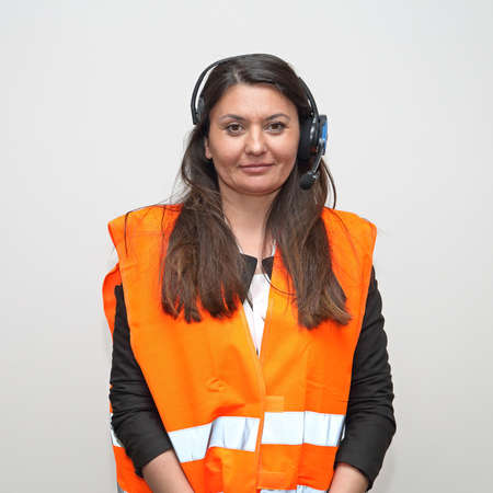 Brunette Woman Worker With Wireless Headset Voice Picking System Control