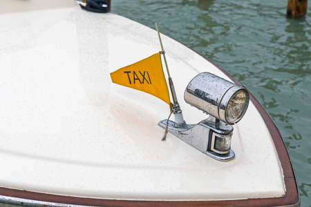 Sign Taxi Flag at Boat in Venice Italy
