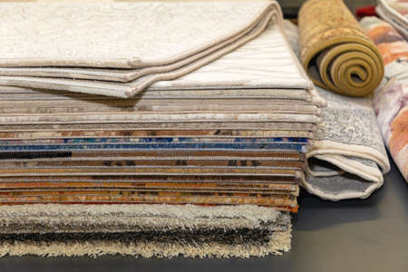 Stacked Layers of Carpets and Rugs Variety Selection