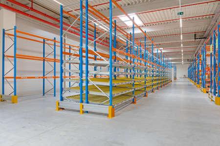 Gravity Flow Rack Shelving in Distribution Warehouse