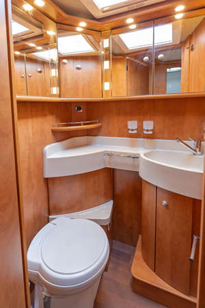Ceramic Sink and Cassette Toilet With Mirror Cabinets Camper Van