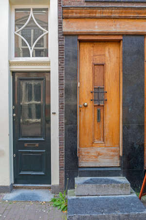 Two Different Doors at Houses in Amsterdam
