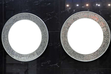 Two Round Mirrors at Black Marble Wall Bathroom