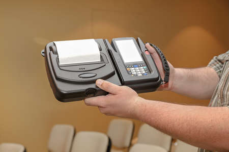 Man Holding Portable Barcode Printer and Scanner Set Device