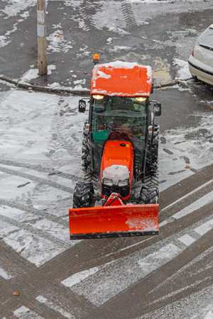 Snow Plow Tractor Vehicle at Street Winter Weather