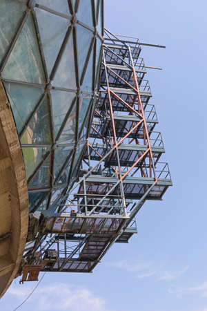 Scaffoldings at Oval Glass Building Structure Construction Site