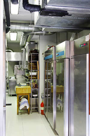 Professional kitchen interior with equipment and refrigerators