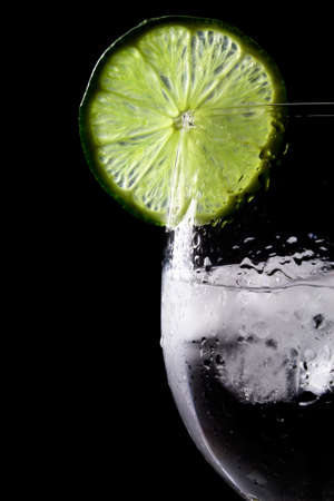 Glass with lime and ice photo