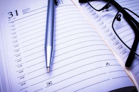contact sheet: Address book, pen   black glasses