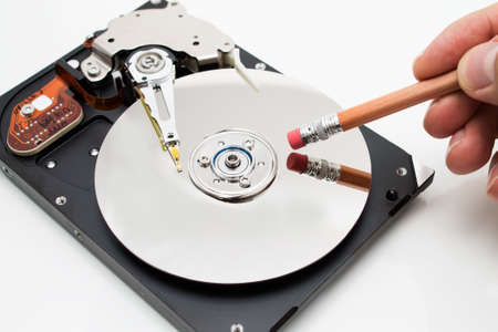 Hard disk drive data erase metaphor Stockfoto