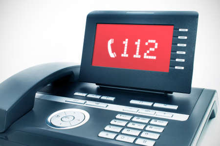 emergency call: Modern phone with a  112  sign on a display Stock Photo
