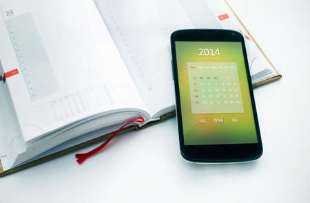 Modern mobile phone with calendar for May 2014  Concept for business devices photo