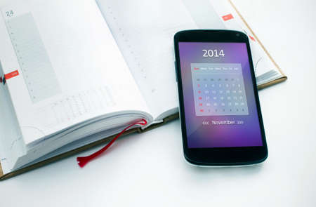 Modern mobile phone with calendar for November 2014  Concept for business devices photo