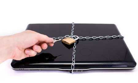Laptop with chains and padlock photo