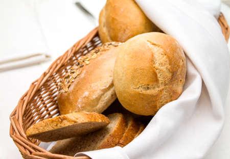 life loaf: Wicker basket of freshly baked dinner rolls
