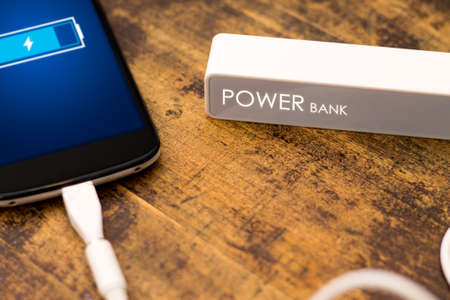 the depth: Phone charging with energy bank. Depth of field on Power bank