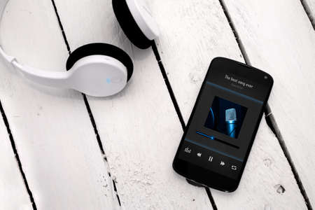 Concept of listening music from smartphone with wireless technology.