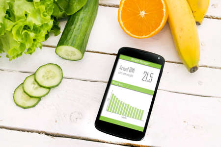 Control of your weight loss with mobile application. Stock Photo