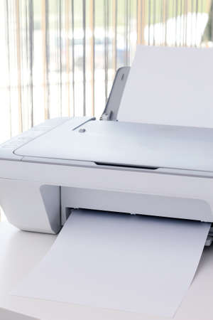 White printer on the desk in office