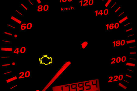 dash: Check engine light. Car dashboard in closeup Stock Photo