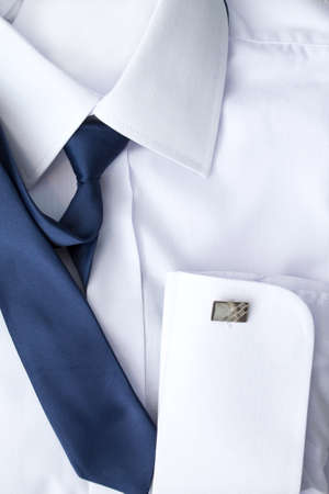 cuff: Mans white shirt with blue tie and cufflinks