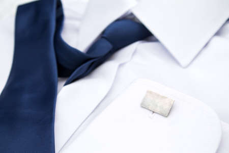 drycleaning: Mans white shirt with blue tie and cufflinks