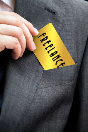 freelance: Freelance working concept. Man pulls out a business card from his suit pocket